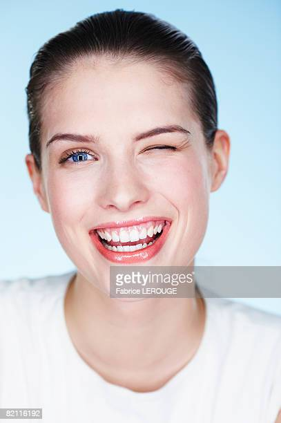 Portrait of young smiling woman winking