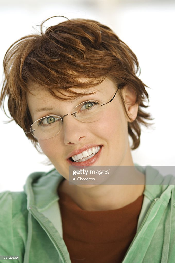 Portrait of young smiling woman with eye glasses : Stock Photo