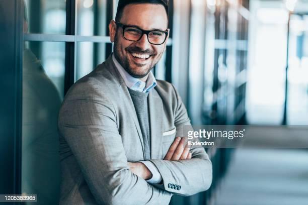 portrait of young successful businessman - mezzo busto foto e immagini stock