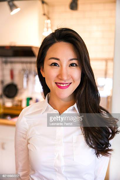 Portrait of young successful woman at home in Seoul