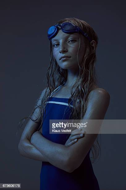 Portrait of young swimmer with crossed arms