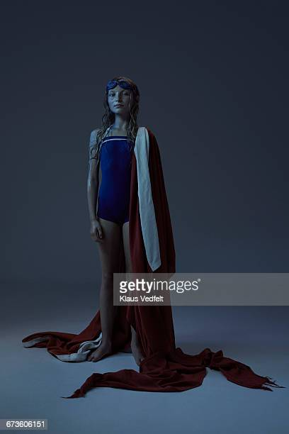 portrait of young swimmer wrapped in big flag - オリンピック選手 ストックフォトと画像