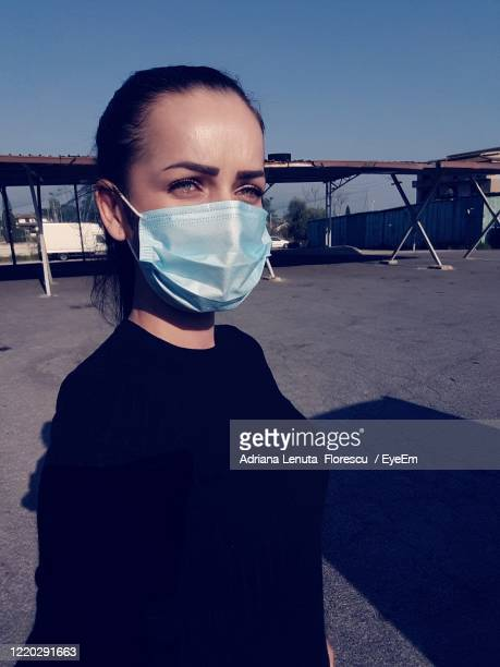 portrait of young woman against clear sky - corona sun stock pictures, royalty-free photos & images