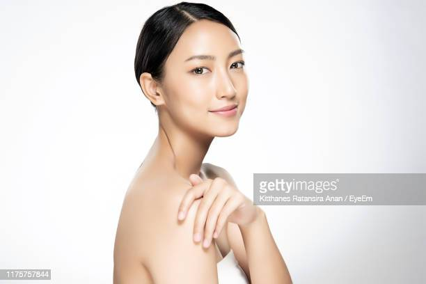portrait of young woman against white background - 美容 ストックフォトと画像