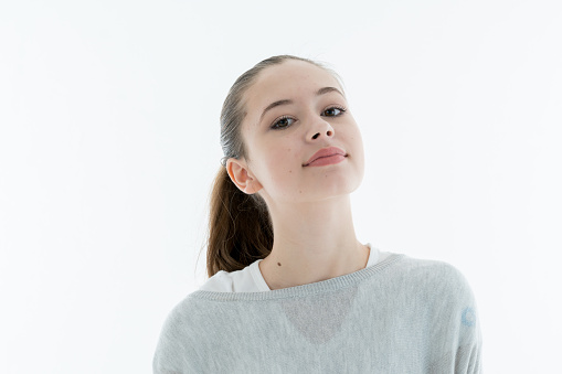 Portrait Of Young Woman Against White Background - gettyimageskorea