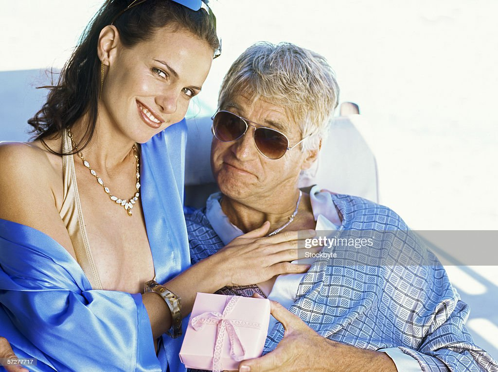 Portrait of young woman and a mid adult man : Stock Photo