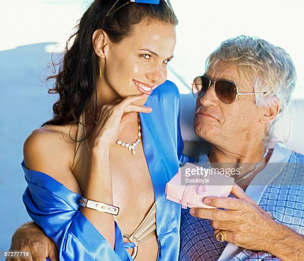 portrait of young woman and a mid adult man - sugar daddy stock photos and pictures