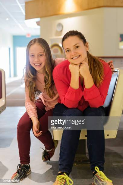 Portrait of young woman and preteen girl playing bowling.