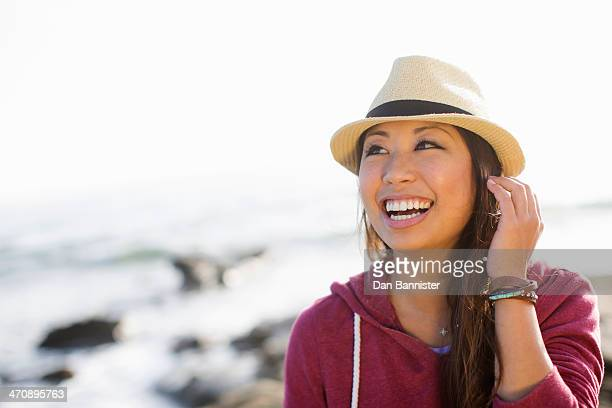 Portrait of young woman at coast, San Diego, California, USA