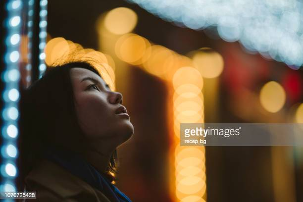 portrait of young woman at night - looking up stock pictures, royalty-free photos & images