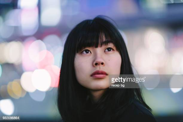 portrait of young woman at night - differential focus stock pictures, royalty-free photos & images