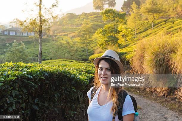 Portrait of young woman at tea plantations near Munnar, Kerala, India