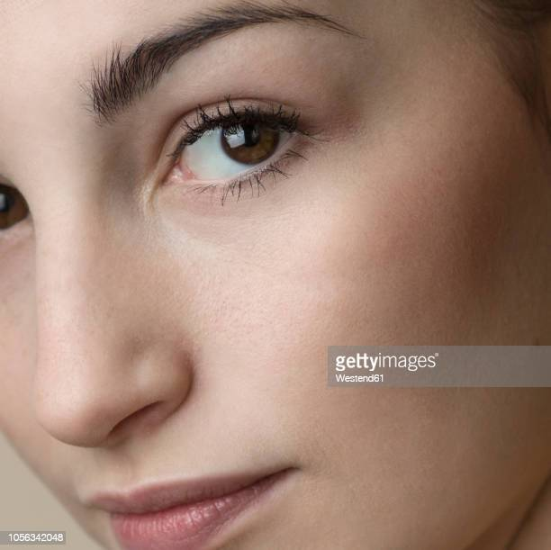 portrait of young woman, close-up - cheek stock pictures, royalty-free photos & images