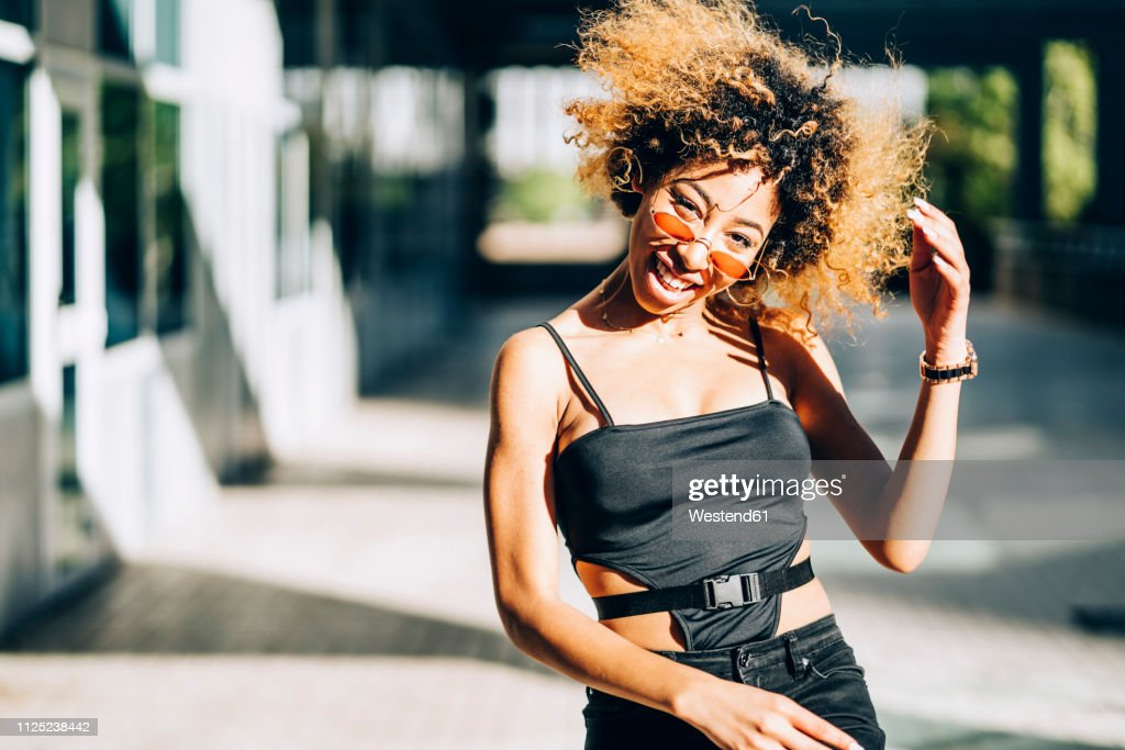 Portrait of young woman dancing outdoors : Stock Photo