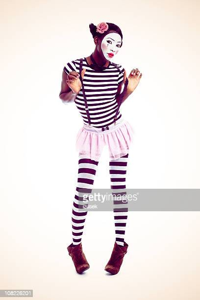 portrait of young woman dressed as a mime - mime stock photos and pictures