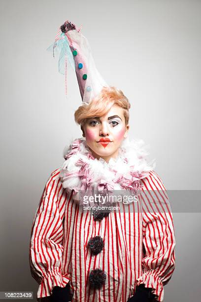 portrait of young woman dressed as clown - sad clown stock photos and pictures