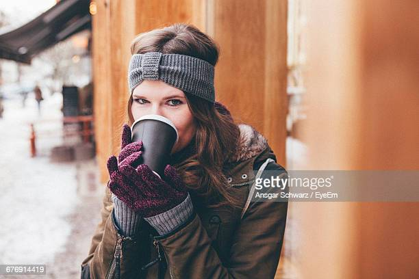 Portrait Of Young Woman Drinking Coffee Outdoors