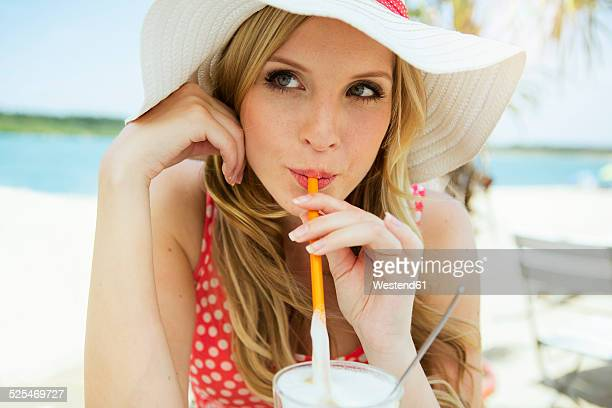 Portrait of young woman drinking Latte macchiato