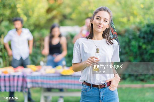 portrait of young woman during garden party - hands in pockets stock pictures, royalty-free photos & images