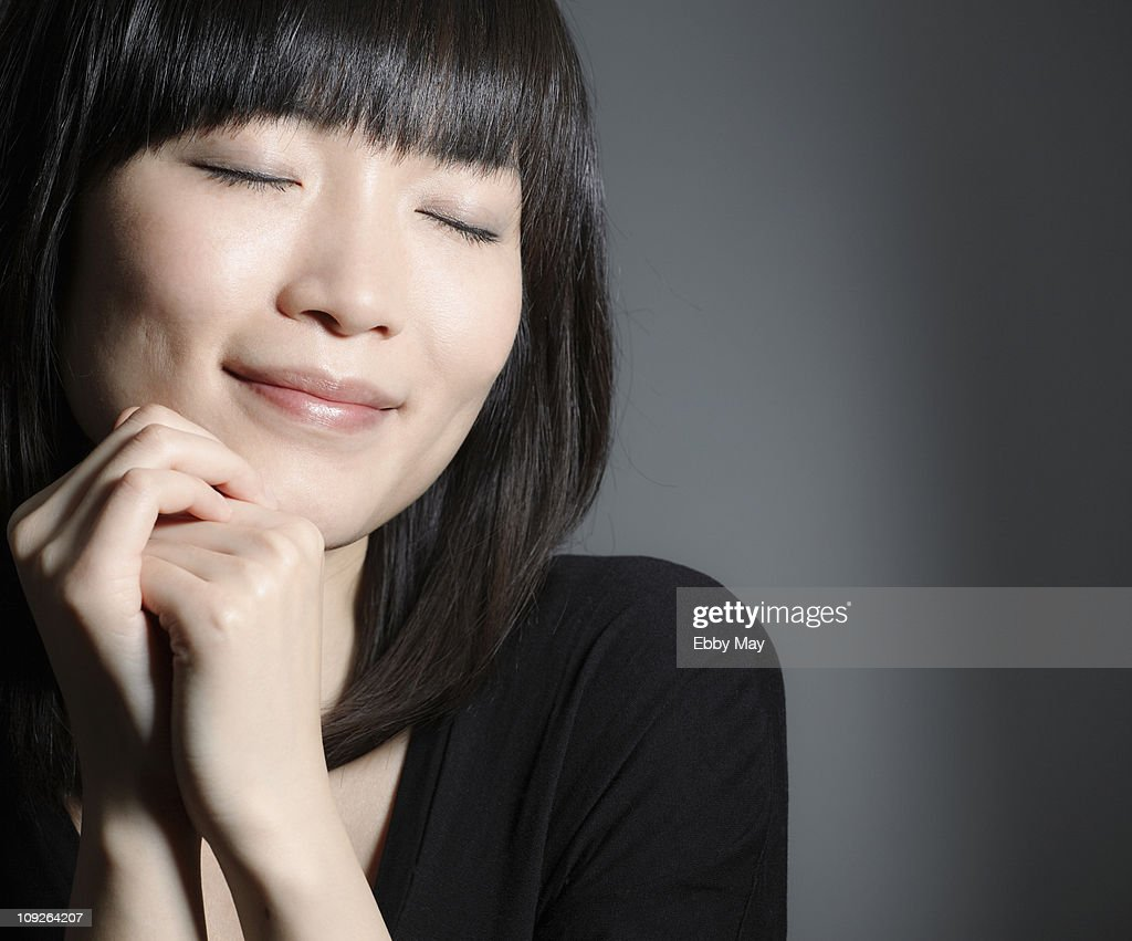 Portrait of young woman, eyes closed : Stock Photo