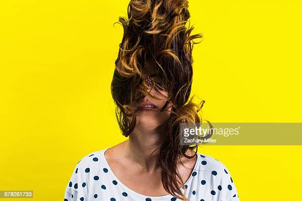 Portrait of young woman flicking hair