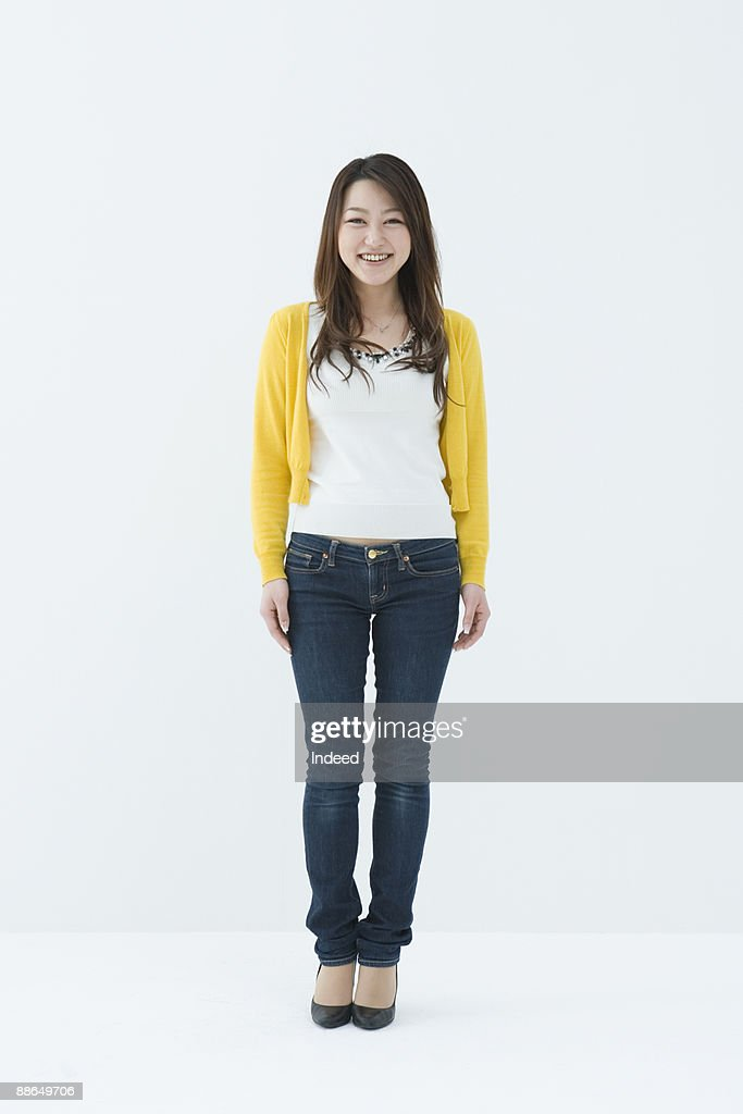Portrait of young woman, full length : ストックフォト