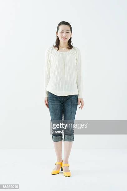 portrait of young woman, full length - rolled up pants stock pictures, royalty-free photos & images