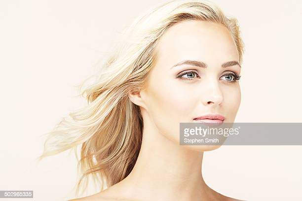 Portrait of  young woman hair blowing in wind