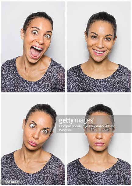 Portrait of young woman having fun in photo booth