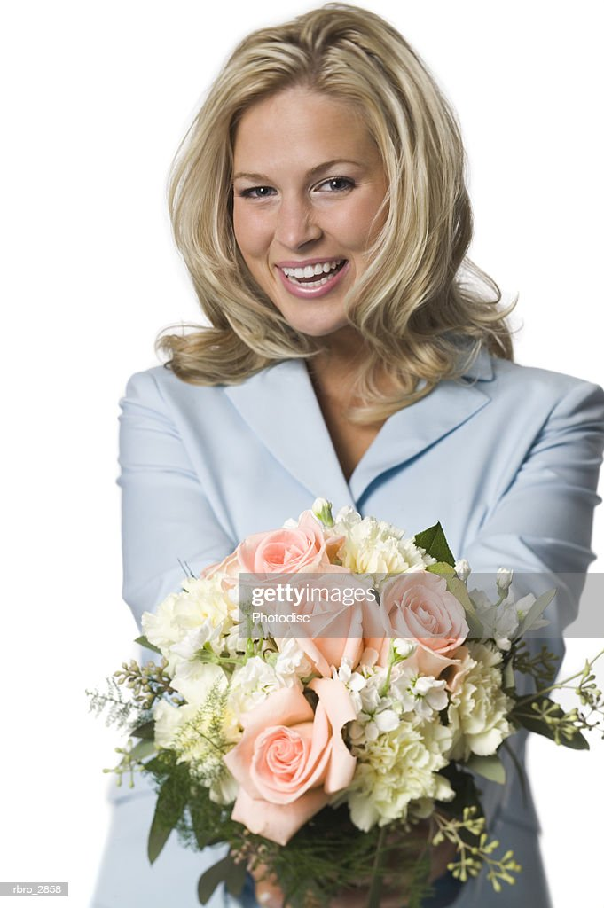 Portrait of young woman holding a bouquet of flowers : Foto de stock