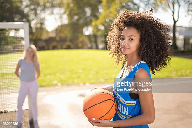 portrait of young woman holding basketball - bethnal green stock pictures, royalty-free photos & images