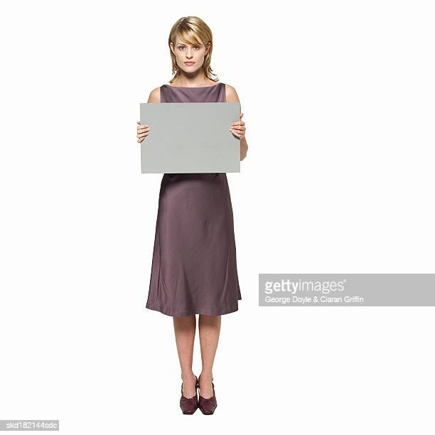 Portrait of young woman holding blank card
