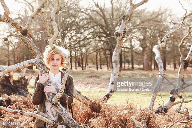 portrait of young woman holding branch at richmond park - bortes cristian stock photos and pictures