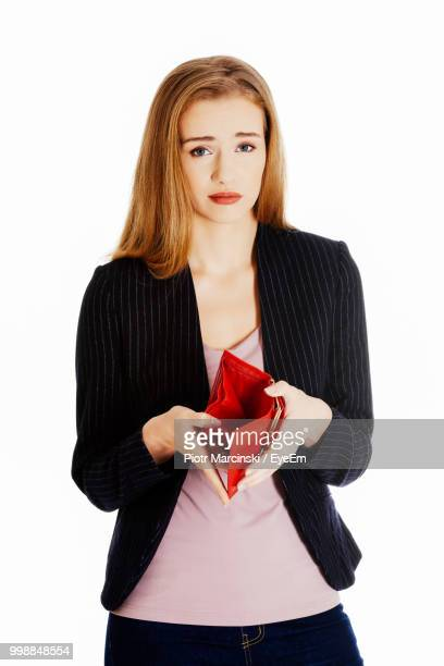 portrait of young woman holding empty purse against white background - 膝から上の構図 ストックフォトと画像
