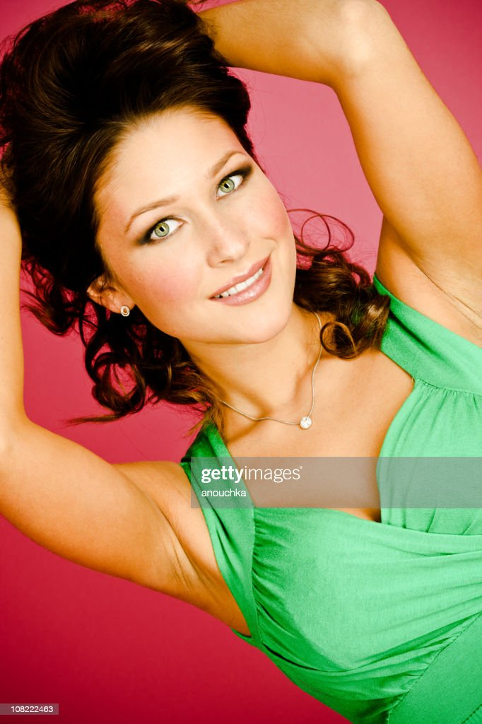 Portrait of Young Woman Holding Hair Up with Hands : Stock Photo