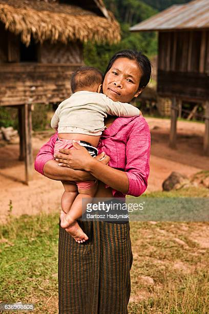 Portrait of young woman holding her baby in Northern Laos
