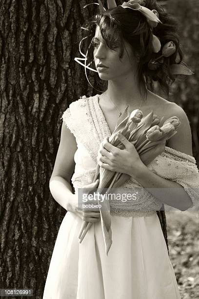 Portrait of Young Woman Holding Tulip Bouquet, Sepia Toned