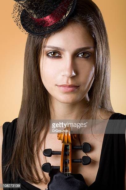 Portrait of Young Woman Holding Violin