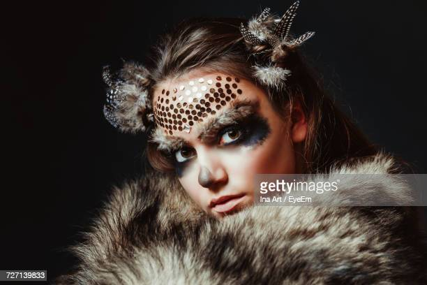 Portrait Of Young Woman In Animal Face Paint