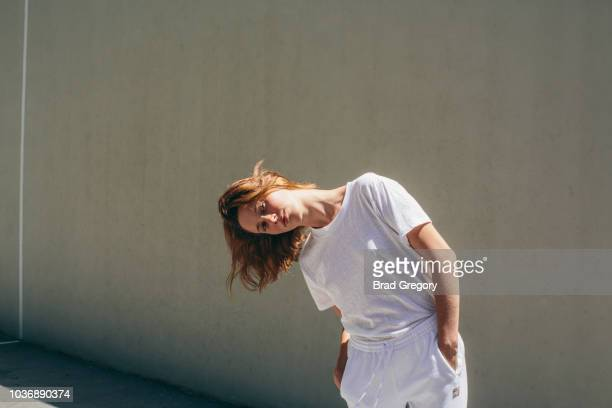 portrait of young woman in athletic attire in handball court - draft sports stock pictures, royalty-free photos & images