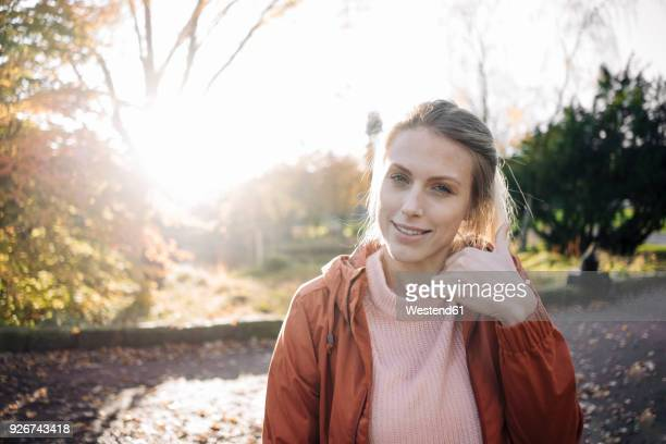 Portrait of young woman in autumnal park