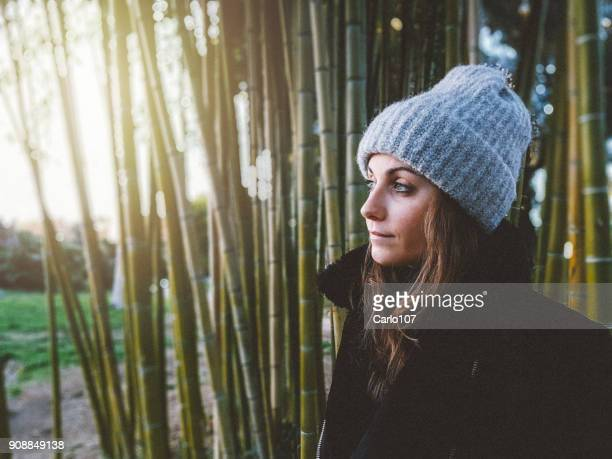 Portrait of young woman in bamboo forest