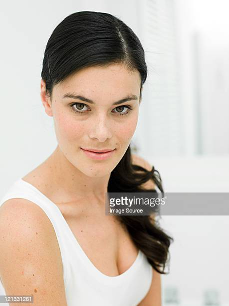 Portrait of young woman in bathroom