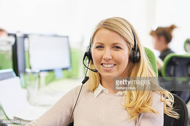 Portrait of young woman in call centre