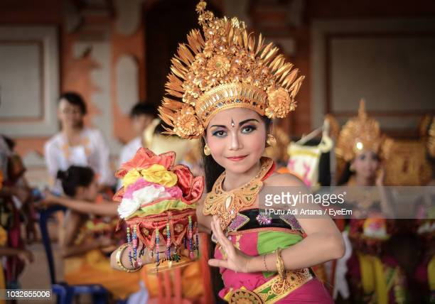 portrait of young woman in costume dancing during celebration - balinese culture stock pictures, royalty-free photos & images