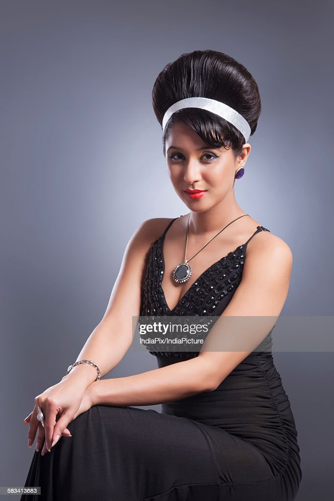 Portrait of young woman in evening gown : Stock Photo