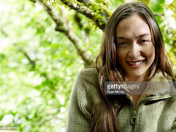 Portrait of young woman in forest.