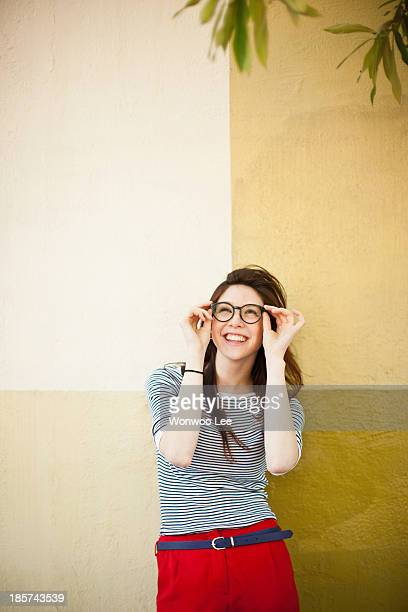 Portrait of young woman in front of color divided wall