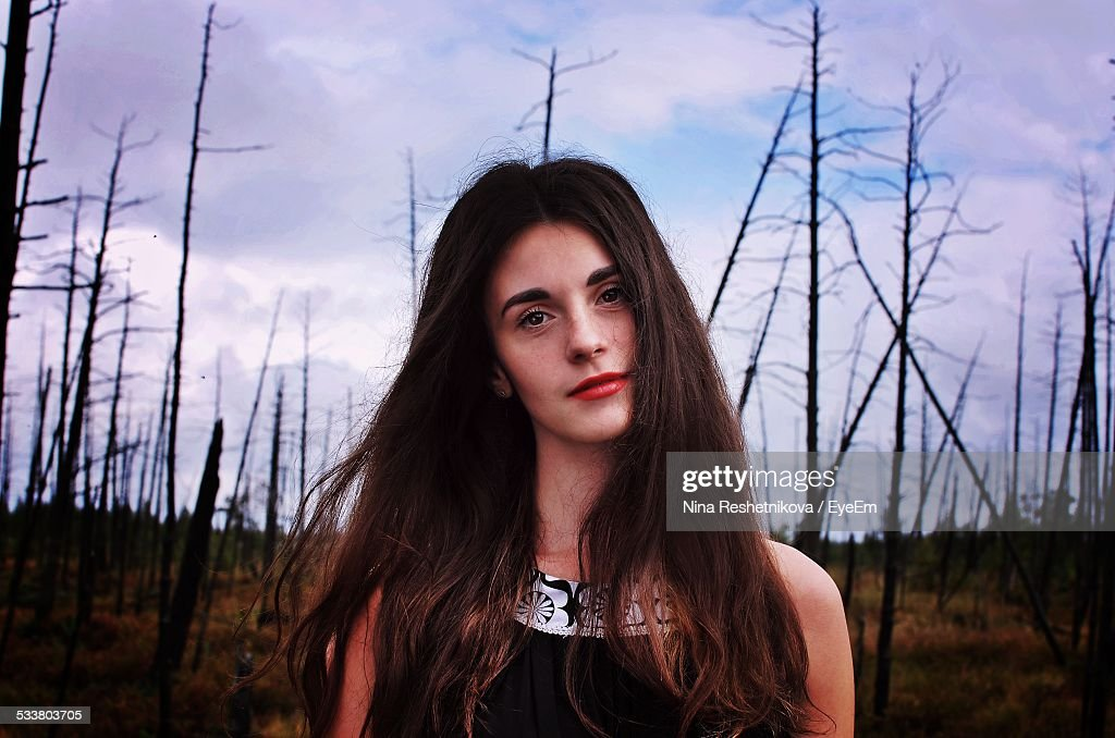 Portrait Of Young Woman In Front Of Damaged Forest : Foto stock