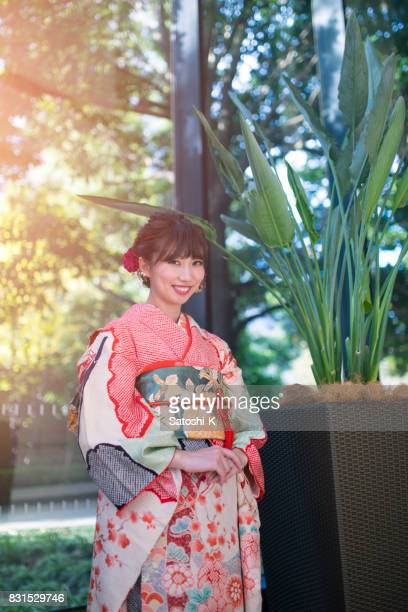 portrait of young woman in furisode kimono for coming of age ceremony - seijin no hi stock pictures, royalty-free photos & images
